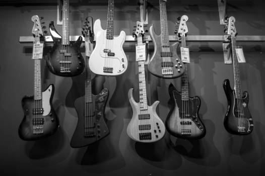 8 Electric Guitars Hanged on Brown Steel Bar #34855
