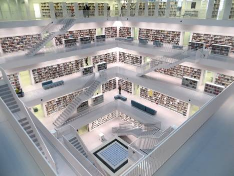 White Concrete Tall Building With Books Free Photo