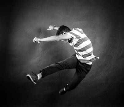 Grayscale Photograph of Man Wearing White and Black Stripe Crew Neck T Shirt Free Photo