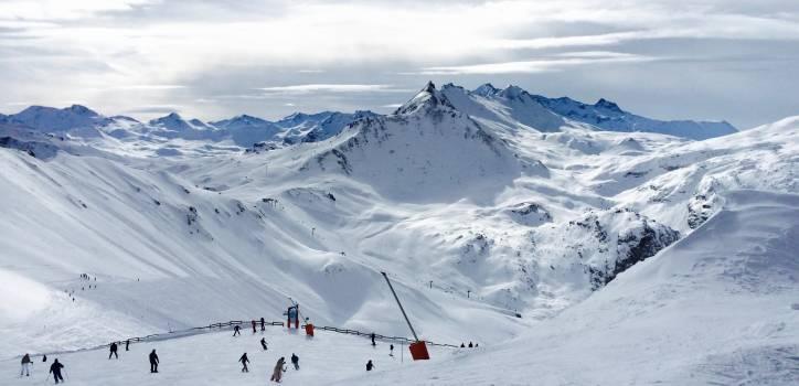 People Lurking Around on Snow Field Near Mountains #35129