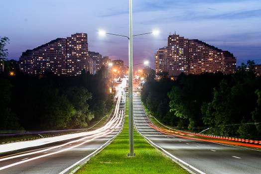 Grey Lamp Port Between Grey Concrete Road #35158