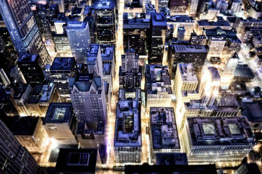 Aerial View of Building With Lights on during Night Time Free Photo