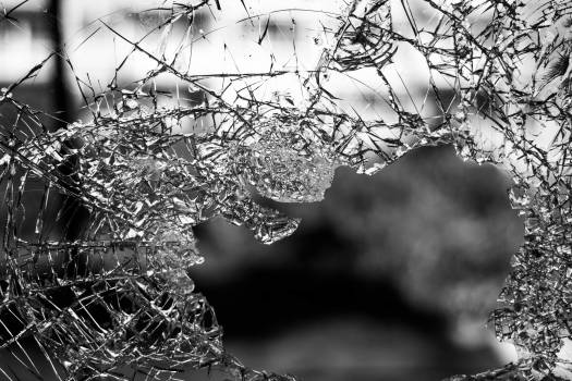 Hole on Shattered Glass Free Photo