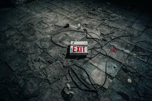 White and Illuminated Exit Signage on Gray Concrete Tile Free Photo