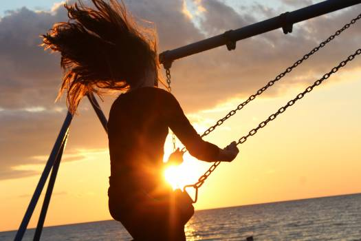 Woman on Swing during Sun Set #35895