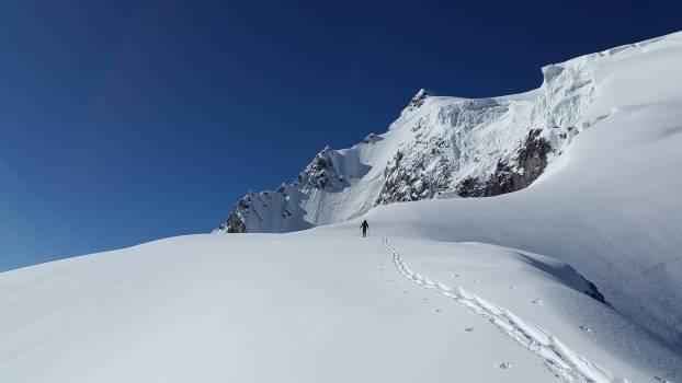 Man Walking in White Mountain Snow during Daytime #35927