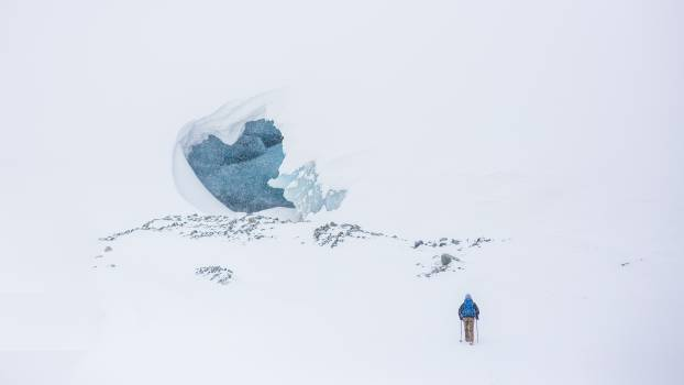 Person Wearing Blue Bubble Jacket on Snow Covered Field during Day #35979