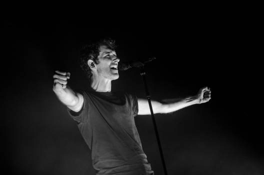 Greyscale Photo of Man Singing #36242
