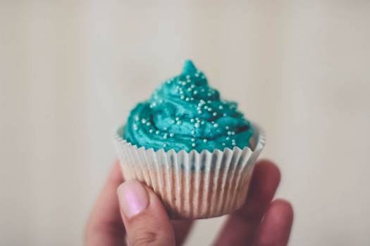 Cupcake With Teal Icing and Sprinkles Free Photo