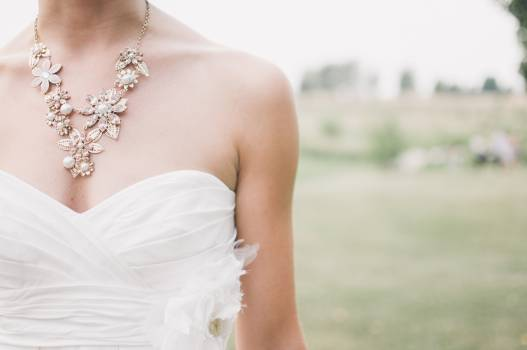 Woman in White Dress Wearing Gold Chunky Necklace during Daytime #36408