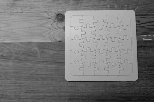 Gray Scale Photo of Jigsaw Puzzle Free Photo
