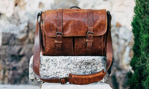 Brown Messenger Bag on Top of Stone #36656