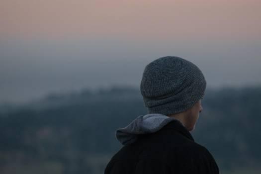 Man Wearing Gray Knit Cap and Black Jacket Free Photo