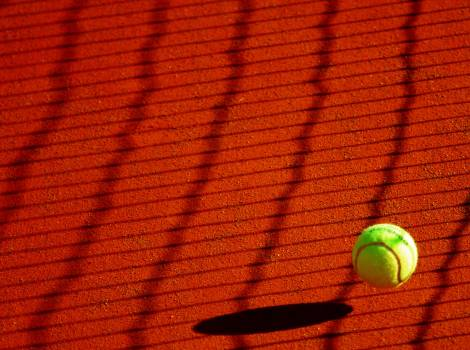 Green Tennis Ball on Red Floor during Sunny Day #36914