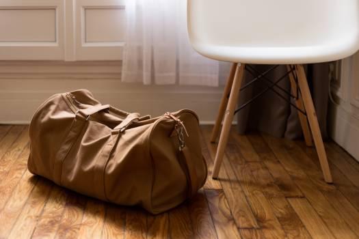 Brown Sports Bag on Parquet Floor #37125