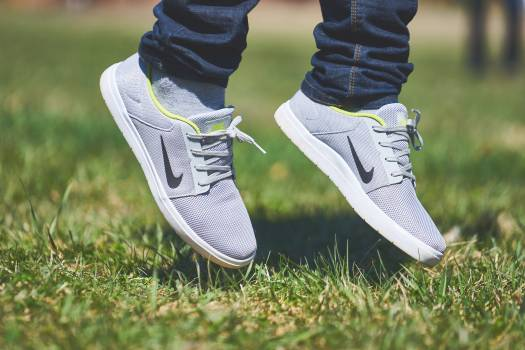Person Wearing Grey and White Nike Sneaker Free Photo