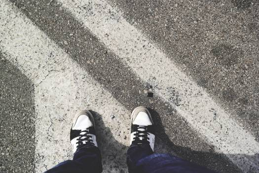 Man in White and Black Sneakers Standing Outdoor during Daytime #37413