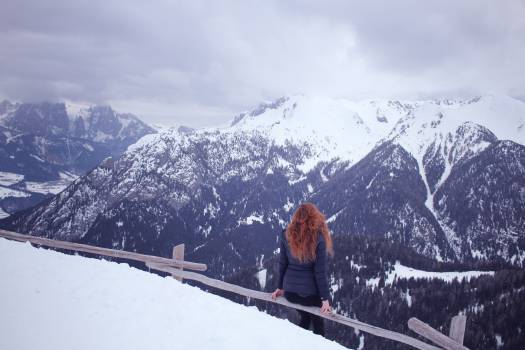 Woman Wearing Blue Bubble Coat at the Pick of the Mountain during Winter Season #37877