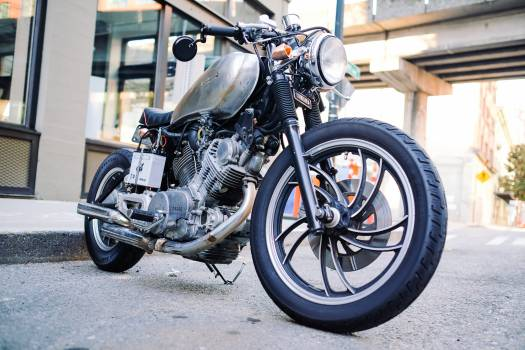 Black and Silver Cruiser Motorcycle on Gray Ground Free Photo