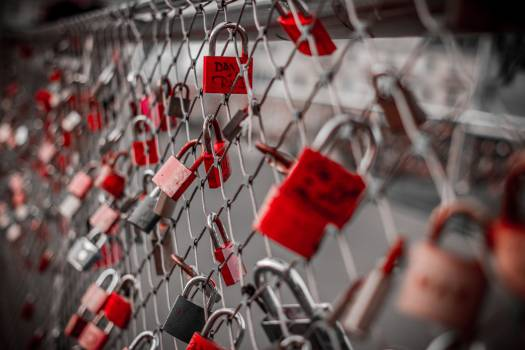 Red Padlock on Cyclone Fence Free Photo