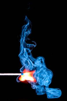 Lighted Match With Smoke on Black Background Free Photo