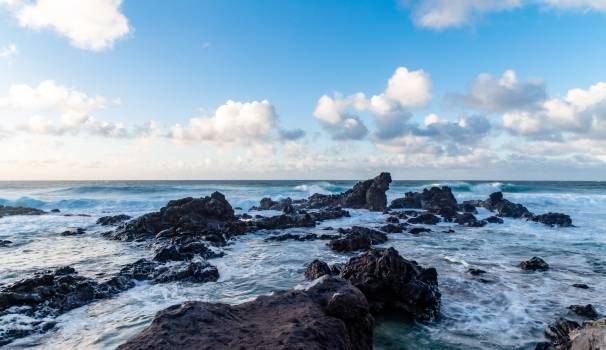 Sea Waves With Rock Formation Under the Blue Sky #38138