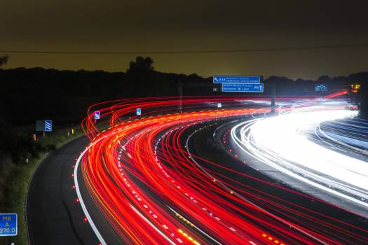 Time Lapse Photography of Car Passing by the Winding Road during Nighttime Free Photo