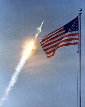 The American Flag heralds the flight of Apollo 11 in Cape Canaveral, Florida. Original from NASA.  #383771