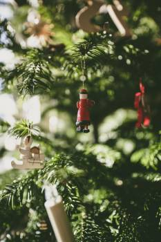 Miniature decoration hanging on a Christmas tree #383925