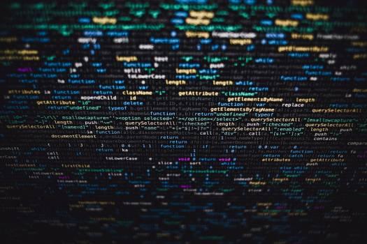 Software developer programming code on black background #384011