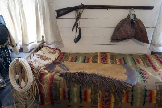 Some of the genuine Old West possessions displayed inside a bunkhouse — a small railroad office moved to the location and converted for ranch use — on a ranch owned by Annie Young Shelton and Ferol Shelton near Clarendon in the Texas Panhandle #384054