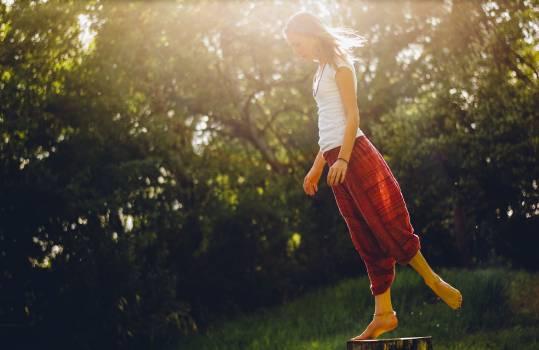 Woman Doing Balancing Stunt Near Trees #38449