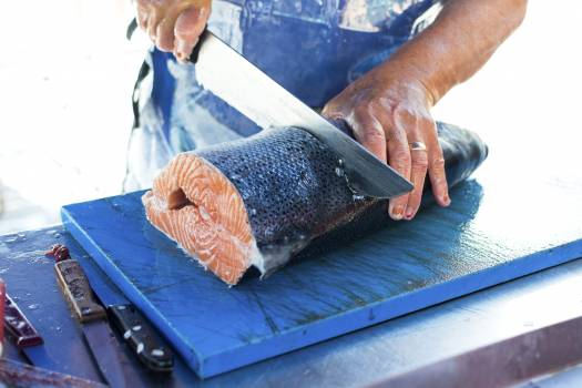 Fresh salmon being sliced at a market #384531