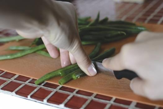 Cutting green beans Free Photo