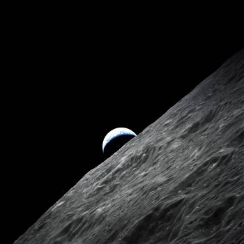 Crescent Earth rises above the lunar horizon taken during the Apollo 17 mission. Original from NASA.  #384961
