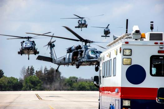 Helicopters with medical personnel arrive at the Shuttle Landing Facility at NASA's Kennedy Space Center in Florida before space shuttle Discovery's landing. Original from NASA.  #385083