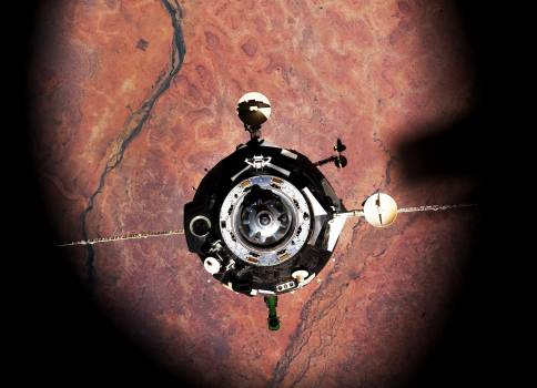 The Soyuz TMA-16 spacecraft is featured in this image photographed by an Expedition 22 crew member on the International Space Station during the relocation of the Soyuz from the Zvezda Service Module's aft port to the Poisk module. Original from NAS #385133