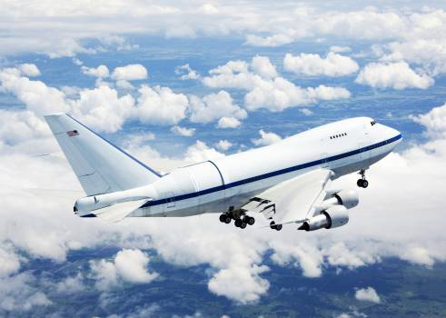 NASA's Boeing 747SP SOFIA airborne observatory soars over a bed of puffy clouds during its second checkout flight over the Texas countryside on May 10, 2007. Original from NASA.  #385143