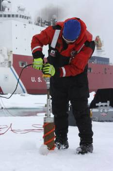 Benny Hopson from the Barrow Arctic Science Consortium in Alaska drills a core sample from sea ice in the Chukchi Sea on July 4, 2010. Original from NASA.  #385212