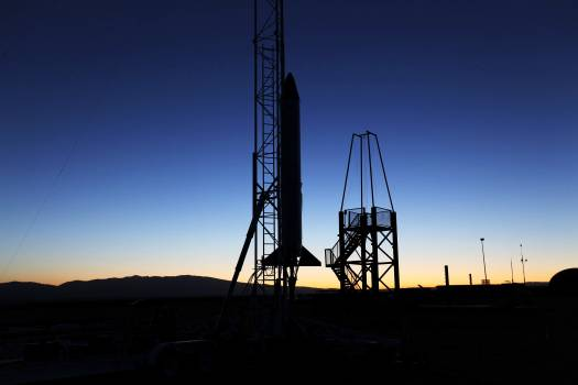 As the sun rises in the Mojave Desert in California, the Garvey Spacecraft Corporation's Prospector P-18D rocket is positioned for launch with the RUBICS-1 payload on a high-altitude, suborbital flight. Original from NASA .  Free Photo