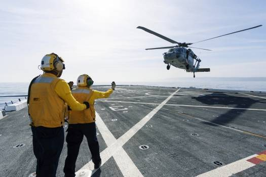On the top deck of the USS San Diego, U.S. Navy personnel monitor a helicopter landing after an Orion underway recovery test. Original from NASA .  #385292
