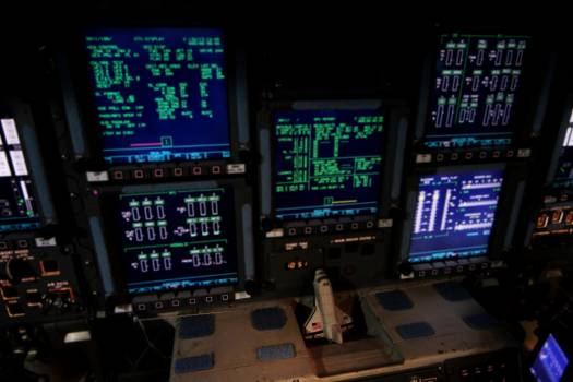 In Orbiter Processing Facility-2 at NASA's Kennedy Space Center in Florida, the consoles on space shuttle Endeavour's flight deck are illuminated for the final time during operations to power down the shuttle. Original from NASA .  Free Photo