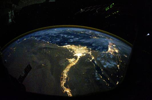 Night time photo featuring the bright lights of Cairo and Alexandria, Egypt on the Mediterranean coast. The Sinai Peninsula, at right, is outlined with lights highlighting the Gulf of Suez and Gulf of Aqaba. Original from NASA.  Free Photo
