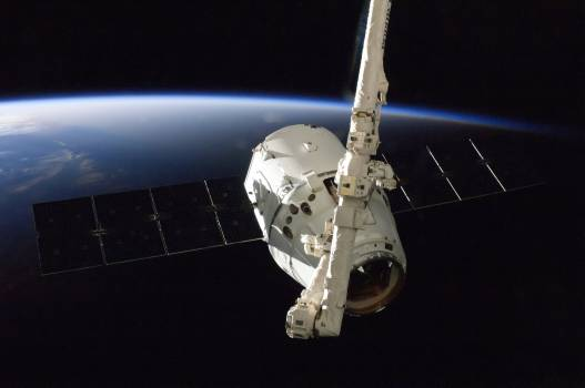 The SpaceX Dragon commercial cargo craft is grappled by the International Space Station's Canadarm2 robotic arm. Oct 10th, 2012. Original from NASA .  #385359