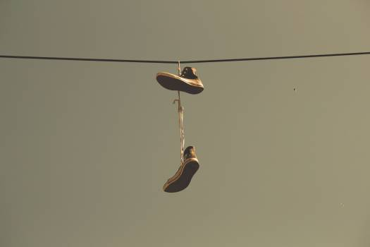 White Black High Top Shoes Hanging on Electric Line #38546