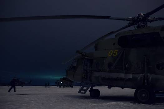 Russian Search and Rescue helicopter teams wait to take off from Kustanay, Kazakhstan to support the Soyuz TMA-13M spacecraft landing with Expedition 41. Original from NASA.  #385503