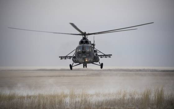 A Russian search and rescue helicopter arrives at the Soyuz TMA-13M spacecraft landing site, 2014-11-10. Original from NASA.  #385510