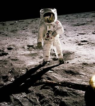 Edwin Aldrin walking on the lunar surface. Neil Armstrong, who took the photograph, can be seen reflected in Aldrin's helmet visor. Original from NASA.  Free Photo