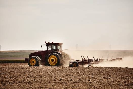 A farmer kicks up dust as he readies the ground for planting near Bristol in Prowers County, Colorado. Original image from Carol M. Highsmith's America, Library of Congress collection.  Free Photo