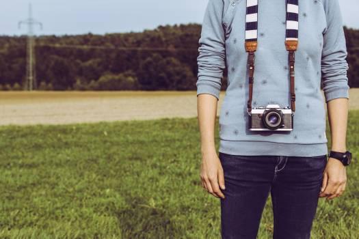 Man with an analog camera Free Photo